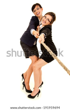 two young business woman, pulling the rope, white background, full lenght