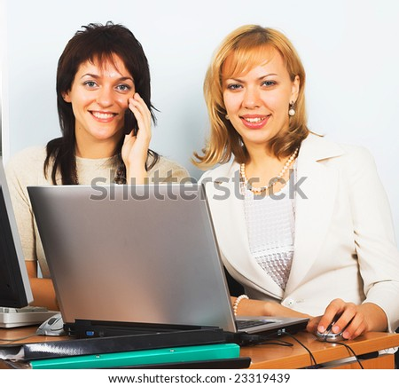 Two Young business woman working on laptop