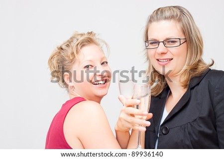 Two young business women enjoying party. - stock photo