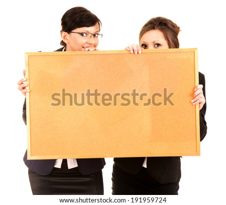two young business women holding the cork board, white background - stock photo
