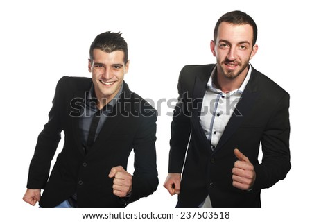 Two Young businessman runs happily on way to the office - stock photo