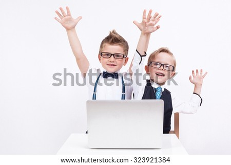 Two young businessman student wearing a shirt with a tie and glasses working at the computer on a white background, picture with depth of field. - stock photo