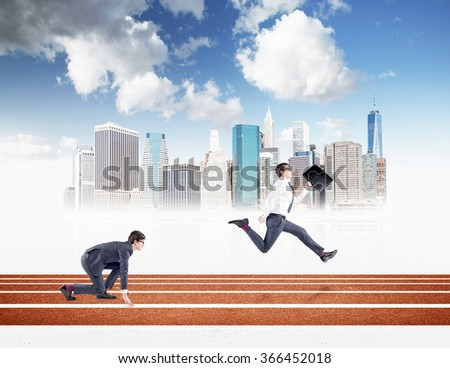 Two young businessmen competing on the track. One in crouch start, the other running forward with a black folder. New York and blue sky at the background. Concept of competition. - stock photo