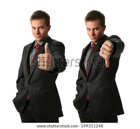 Two young businessmen making his thumb up saying OK and down isolated on white. Hand in focus - stock photo