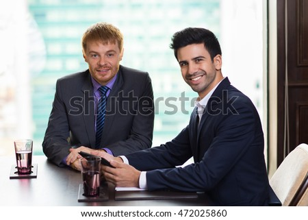 Two Young Businessmen Posing to Camera