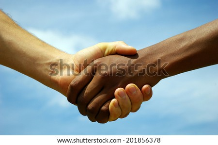 Two young businessmen shaking hands - stock photo