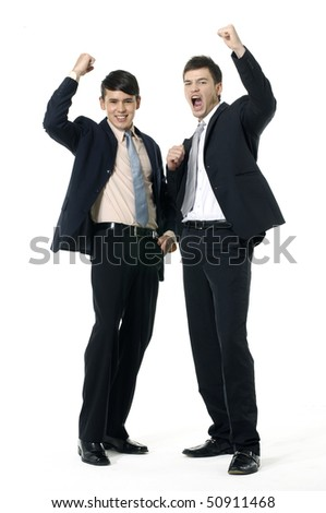 Two young businesspeople raising hands - stock photo