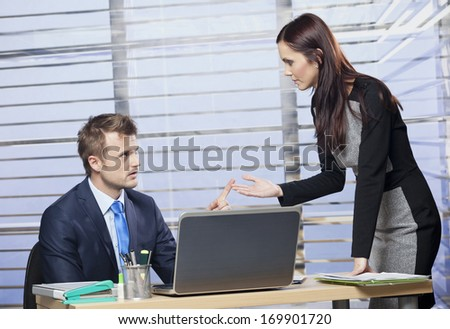 Two young colleagues arguing in office  - stock photo