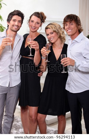 Two young couples drinking champagne