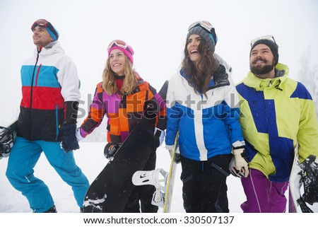 Two young couples on the slope