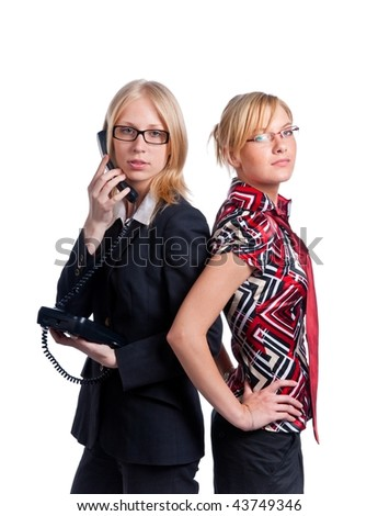 Two young cute business women on white background. Isolated