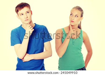 Two young dreaming people with finger on chin.  - stock photo