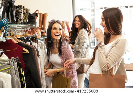 Two young female friends in a shopping, making fun. - stock photo