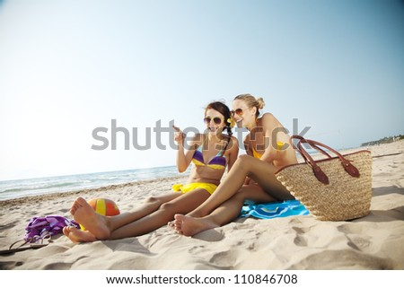 two young females at the beach - stock photo