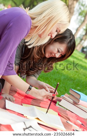 Two Young Friends Laying in the Park - stock photo