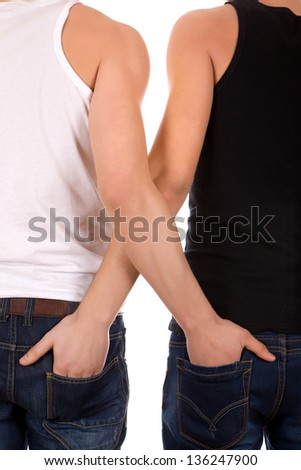 Two young gay man hugging each other - stock photo