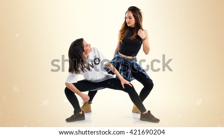 Two young girl dancing street dance