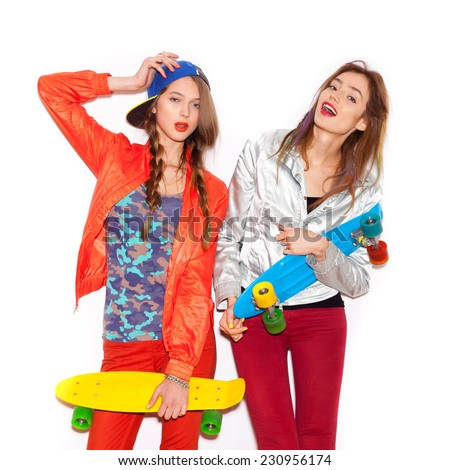 Two young girl friends standing having fun together.  Beautiful woman opening Mouth. Emotion.  Hairstyle. Makeup.  White background, not isolated - stock photo