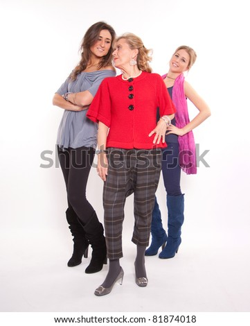 Two young girls and a senior woman with trendy clothes - stock photo
