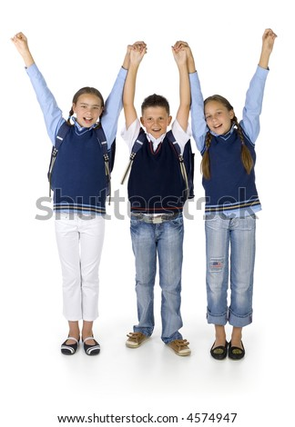 Two young, girls and boy in the middle. Smiling, holding hands up. Looking at camera. Isolated on white in studio, front view - stock photo