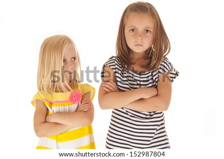 two young girls angry at each other - stock photo