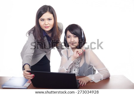 Two young girls, business women on white background - stock photo