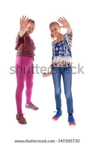 Two young girls in the pink and blue tights standing isolated for white