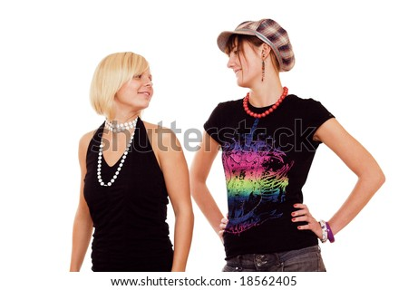Two young girls looking at each other on white background