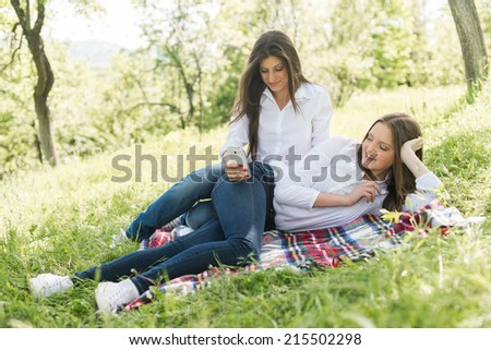 two young girls looking at the phone