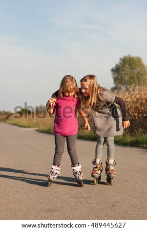 Two young girls on their inline roller skates