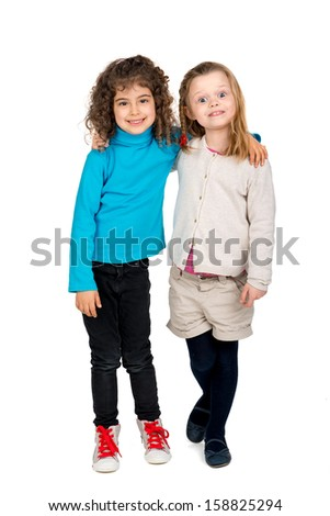 Two young girls posing isolated in white