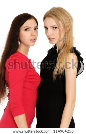 Two young girls posing on white background - stock photo