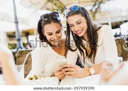 Two young girls talking and smiling during lunch break