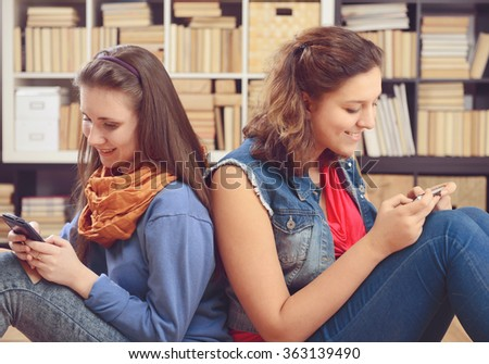 two young girls with smartphone - stock photo