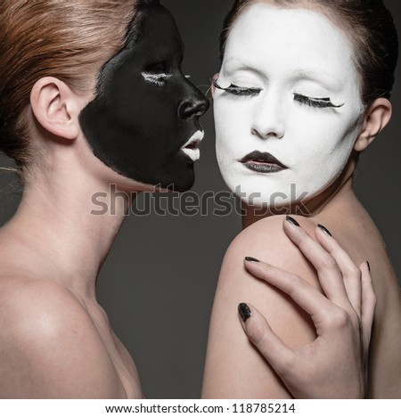 two young girls with ying yang style makeup - stock photo