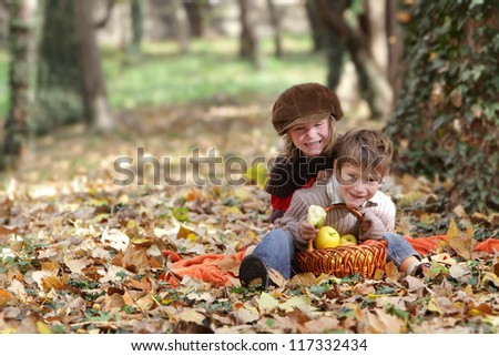 two young happy children - boy and girl - on natural autumn background - stock photo