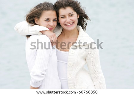 two young happy girls on natural background - stock photo