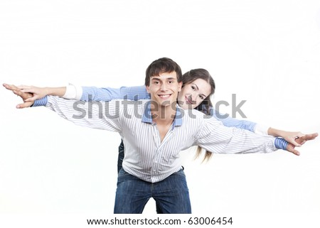 Two young happy person with the hands lifted upwards