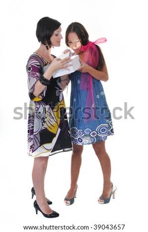two young happy woman giving gift and looking in box at holiday season