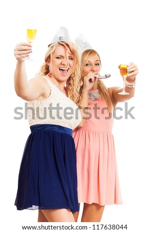 Two young happy women celebrating party, isolated on white background. - stock photo