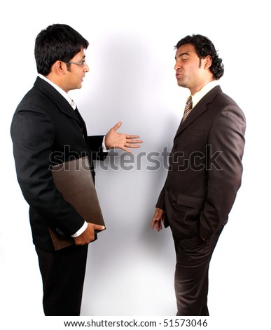 Two young Indian businessman in an argument. - stock photo