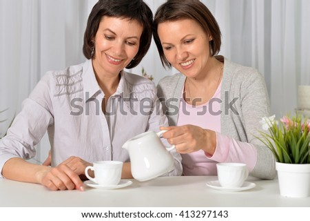 Two young ladies are having tea time