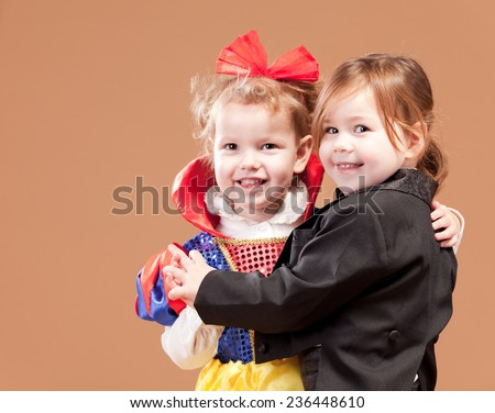 Two young ladies in costume. Studio shot - stock photo