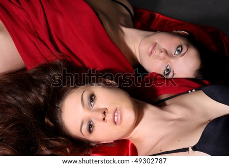 two young lesbian girls lie on floor
