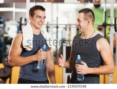Two young man talking in a gym - stock photo