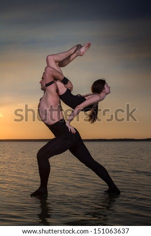Two young men dancing on the surface of the water