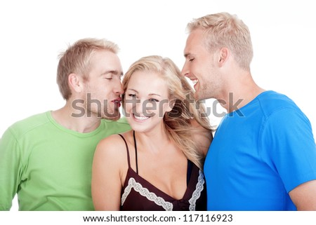 two young men flirting with a woman standing between them - isolated on white