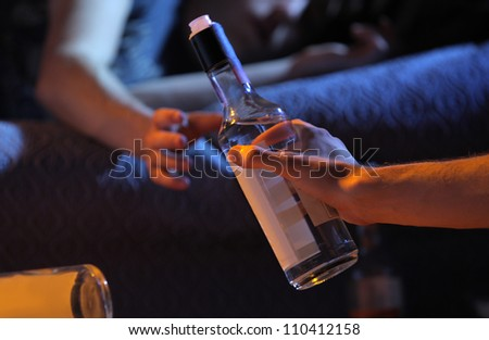 Two young men get drunk at home - stock photo