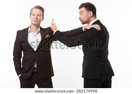 Two young men in suits talking having fun - stock photo