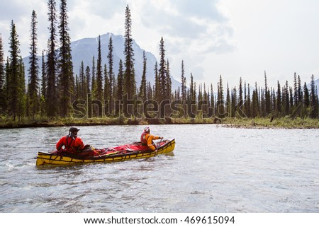 Two young men on a multi-day trip on a river in the far north of North America.